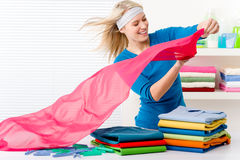 Laundry - woman folding clothes Royalty Free Stock Photos