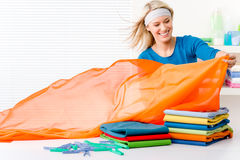 Laundry - woman folding clothes Royalty Free Stock Photo