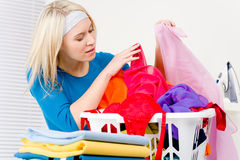 Laundry - woman folding clothes home Royalty Free Stock Photo