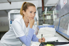 Laundry worker at dry cleaners Royalty Free Stock Photo
