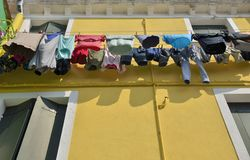 Laundry on on yellow facade Royalty Free Stock Photos