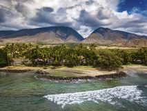Launiupoko Maui Hawaii Aerial Photography with West Maui Mountains. This photo was taken at Launiupoko beach in Maui, Hawaii. In the background you see the West stock photography