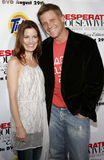 Laura Leighton and Doug Savant. At the Desperate Housewives: Extra Juicy Edition Season 2 DVD Launch held at the Wisteria Lane Universal Studios in Hollywood Stock Images