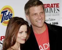 Laura Leighton and Doug Savant. At the Desperate Housewives: Extra Juicy Edition Season 2 DVD Launch held at the Wisteria Lane Universal Studios in Hollywood Stock Image