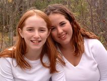 Laura and Mary 1. Two sisters in white tshirts outdoors in the fall Royalty Free Stock Photography