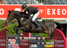 Laura Renwick in action rides horse Beluga Li Royalty Free Stock Images