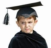 Laureato del bambino con il cappuccio di graduazione Fotografia Stock