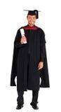 Laureato felice con il suo diploma immagine stock