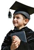 Laureato sveglio del bambino con il cappuccio di graduazione Fotografia Stock Libera da Diritti