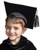 Laureato sveglio del bambino con il cappuccio di graduazione Immagine Stock