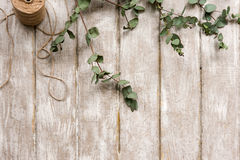 Laurel decor on wood background top view Royalty Free Stock Photo