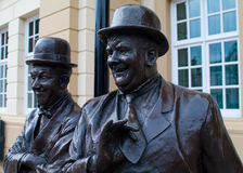 Laurel and Hardy Statue - Ulverston. The Laurel and Hardy statue outside the Coronation Hall in Ulverston, Cumbria, the birthplace of Stan Laurel Royalty Free Stock Photo
