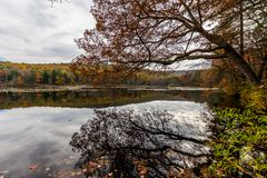 Laurel Lake Recreational Area in Pine Grove Furnace State Park i. N Pennsylvania during fall stock photos