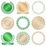 Laurel Leaves Gold Seals. Set of laurel leaves seals in green and gold good for awards, quality, or commemorative use Stock Image