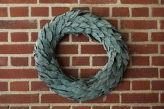 Laurel wreath on brick wall. Royalty Free Stock Images