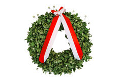 Laurel wreath with a commemorative ribbon isolated on white Stock Photos