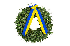 Laurel wreath with a commemorative yellow-blue  ribbon Stock Photo