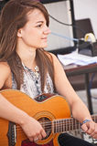 Lauren Dobbie of the band Seirm. Lauren Dobbie  of the band Seirm playing the guitar  at Stock Photos