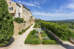 Old houses and garden at  Lauris village in Provence, France. stock image
