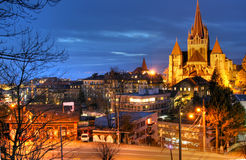 Lausanne Cathedral. The picture was taken from Place de L'Ours, in Lausanne and the biggest building is the cathedral. In the far you can see the lake and the Stock Images
