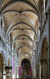 Lausanne cathedral interior from the entrance. Stock Photos