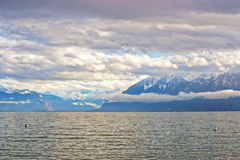 Lausanne quay of Geneva Lake and mountains in Switzerland Stock Image