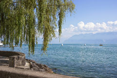 Lausanne quay of Geneva Lake in summer. Time Stock Image
