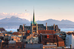 Lausanne, Switzerland. Skyline of Lausanne, Switzerland as seen from the Cathedral hill at sunset zoomed-in on the tower of St-Francois Church. Lake Leman (Lake Stock Photo