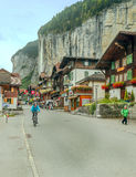 Lauterbrunnen with cars people and flags Stock Photography