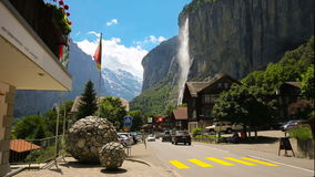 LAUTERBRUNNEN, SWITZERLAND - May 2016- Famous Lauterbrunnen valley with gorgeous waterfall and Swiss Alps in the background stock footage