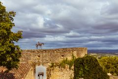 LAUTREC, FRANCE - AUGUST 05, 2017: Sculpture of a rider on horseback on the remains of the medieval wall . LAUTREC, FRANCE - AUGUST 05, 2017: Sculpture of a Royalty Free Stock Photos