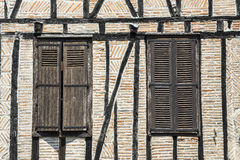 Lautrec (France), old village. Lautrec (Tarn, Midi-Pyrenees, France), medieval village with half-timbered buildings: two windows Royalty Free Stock Photography