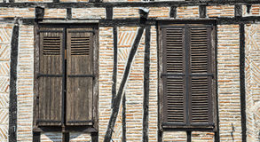 Lautrec (France), old village. Lautrec (Tarn, Midi-Pyrenees, France), medieval village with half-timbered buildings: two windows Royalty Free Stock Images