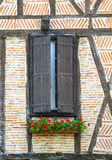 Lautrec (France), old village. Lautrec (Tarn, Midi-Pyrenees, France), medieval village with half-timbered buildings: window with flowers Stock Photo
