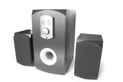 Lautsprecher mit drei Computern Stockbild