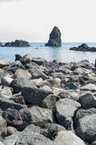 Lava acireale. Typical lava rocks along the coast of acireale, in the sea the characteristic volcanic cliff - marina of Acireale, Catania royalty free stock photography