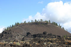 Lava Butte. Is a cinder cone that erupted 7000 years ago and poured out a lava field that covered some ten square miles of evergreen forest south of what is now stock photo