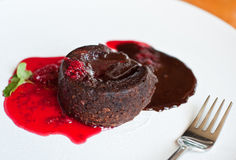 Lava cake and strawberry sauce Stock Photo
