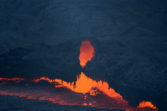 Lava cave. At the edge of the lava lake in the ethiopian Erta Ale volcano Stock Photo