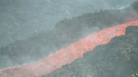 Lava channel. Volcano Etna eruption in August 2014. the eruptive vents in the video were found at the eastern base of the Northeast Crater stock video footage