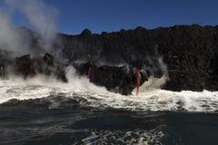 Lava entering the ocean, Big Island, Hawaii. Lava entering the ocean with steam, Big Island, Hawaii Stock Images