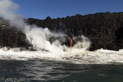 Lava entering the ocean, Big Island, Hawaii. Lava entering the ocean with steam, Big Island, Hawaii Stock Photos