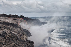 Lava erupting into Pacific Ocean in Hawaii Stock Photography