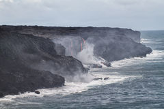 Lava erupting into Pacific Ocean in Hawaii Royalty Free Stock Images