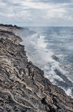 Lava erupting into Pacific Ocean in Hawaii Royalty Free Stock Image