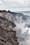Lava erupting into Pacific Ocean in Hawaii Stock Photo