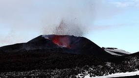 Lava erupting from a volcano crator at Eyjafjallajökull in Iceland.