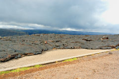 Lava field covering road Stock Image