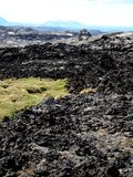 The lava field of Leirhnjukur. Black hot lava field of Leirhnjukur in the north of Iceland Royalty Free Stock Image