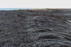 Lava field slope, Big Island, Hawaii. Lava field slope with trees, Big Island, Hawaii Royalty Free Stock Photo